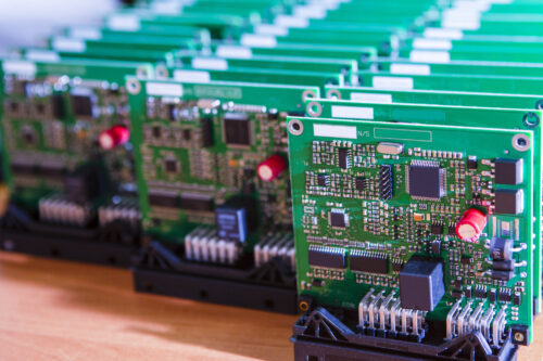 Several printed circuit boards lined up in rows.
